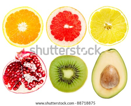 collection of cut tropical fruits on a white