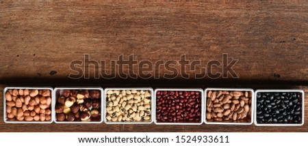 collection of different legumes on wooden background