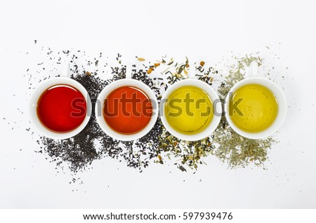 Collection of different teas in cups with tea leaves on a white background. #597939476
