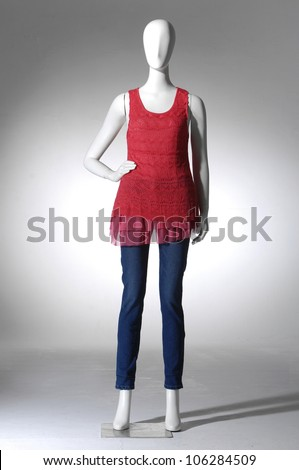 collection of dress in a hat on female mannequin in light background