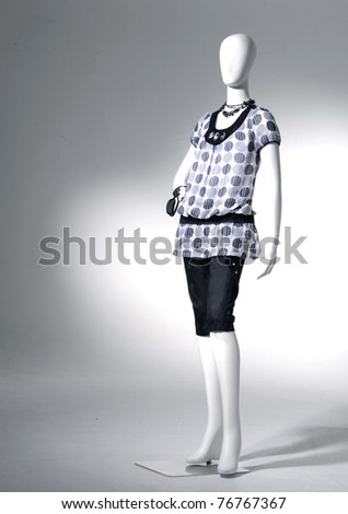collection of dress on mannequin in light background - stock photo