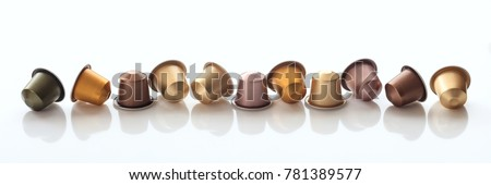Collection of espresso coffee capsules isolated on white background, Closeup view with details, banner