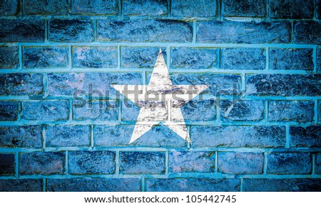 Collection of european flag on old brick wall texture background, somalia