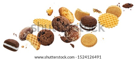 Collection of falling cakes, cookies, crackers, waffles isolated on white background with clipping path. Delicious flying whole and broken sweet biscuits set Photo stock ©