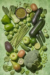 Collection of fresh green vegetables. Broccoli, zucchini, asparagus, beans, brussels sprouts kiwi avocado apple