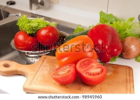 Collection of fresh spring vegetables before salad preparation