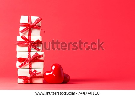 Collection of gift boxes with hearts on a red background #744740110