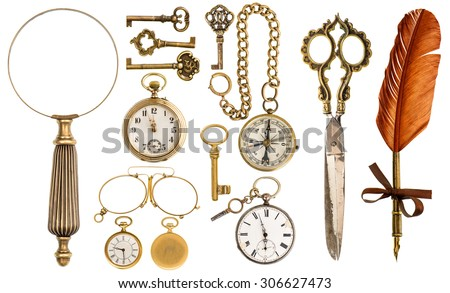 Collection of golden vintage accessories and antique objects. Old keys, clock, loupe, compass, ink feather pen, scissors, glasses isolated on white background stock photo