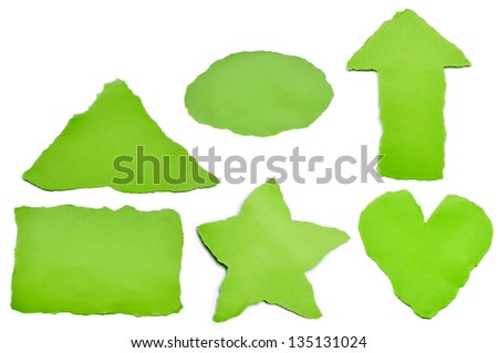 Collection of green paper tears, isolated on white with soft shadows.