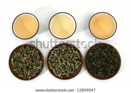 Collection of green teas in cups and on clay plates. Isolated on white. - stock photo
