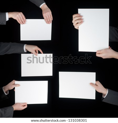 collection of hand holding blank paper on black