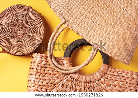 Collection of handmade summer bags on trendy yellow background. Top view. Fashionable stylish accessory. Natural, organic, eco friendly, zero waste, plastic free concept