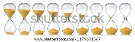 Collection of hourglasses with yellow sand showing the passage of time