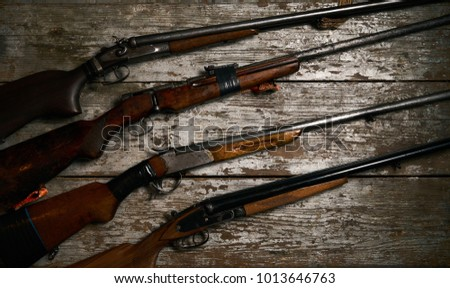 collection of hunting rifles