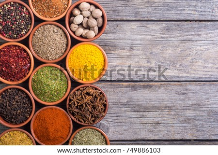 Collection of indian spices in bowl background . Top view