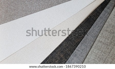 collection of interior wallpaper samples with fabric texture pattern in white ,grey ,beige ,brown and black tone color. luxury material for wall covering.  Foto stock ©