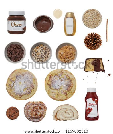 Collection of ketchup bottle, honey, cake, pancake, chocolate cream, cookie, choco muesli, cornflakes, cornflakes choco, salt stick and corn waffle on a white background for design. High quality image #1169082310