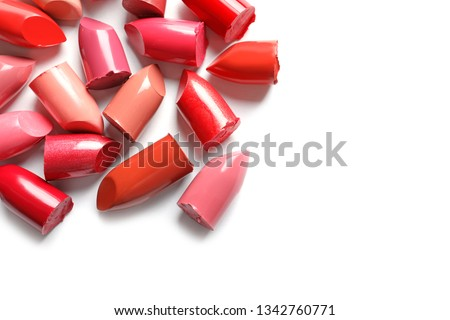 Collection of lipsticks on white background, top view