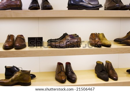 Collection of male leather shoes on display