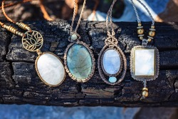 Collection of mineral gemstones jewelry necklaces on natural woody background