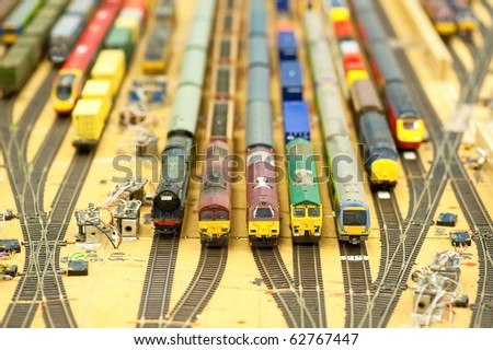 collection of model trains in an unfinished replica station