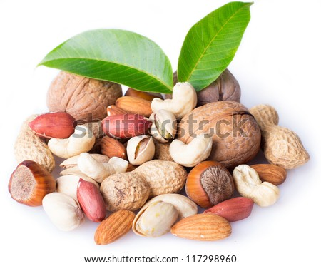collection of nuts with leaves isolated on white