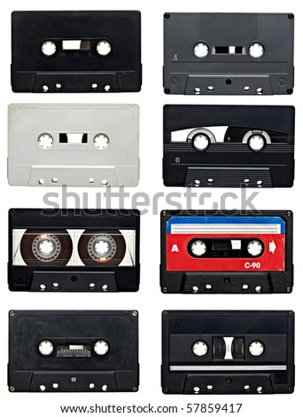 collection of old audio tapes on white background. each one is in full camera resolution