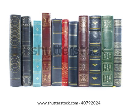 collection of old books lined up on white background