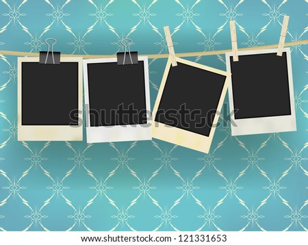 Collection of Old Retro Blank Photo Frames Hanging on Rope - on Vintage Wallpaper