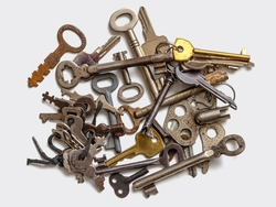 Collection of old used keys from long-broken and lost locks. Key group on a white background