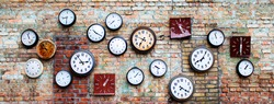 collection of old, vintage, hinged watches, all clock show different times, some do not have insoles, they all hang on an old brick wall, bricks changed color from time to time