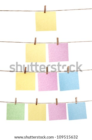 Collection of paper note hanging on the rope isolated over white background