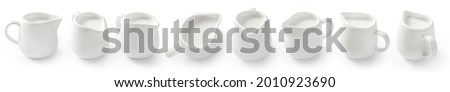 Collection of porcelain milk jars isolated on white background. Milk pitchers for package design. Top view of milk. Porcelain creamer pitcher with milk on white.
