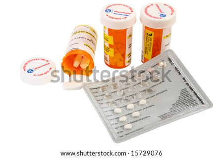 Collection of prescription medicines over white.