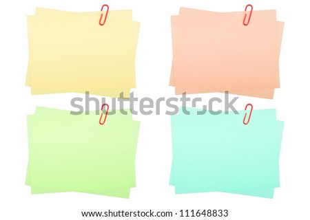 collection of real note papers with paper clip on white background