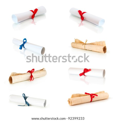 collection of rolls white paper and papirus with ribbons isolated on white