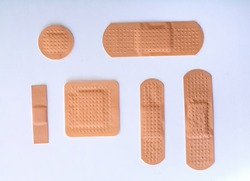 collection of six different bandages on white background