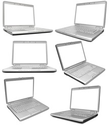 Collection of six silver laptops on white background