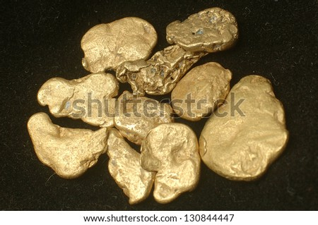 Collection of small gold nuggets from Grey River Gold Dredge, West Coast, South Island, New Zealand