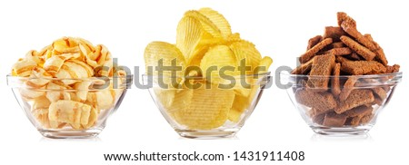 Collection of snacks for beer isolated on white background. Chips and crackers in a transparent plate. Set Stockfoto ©