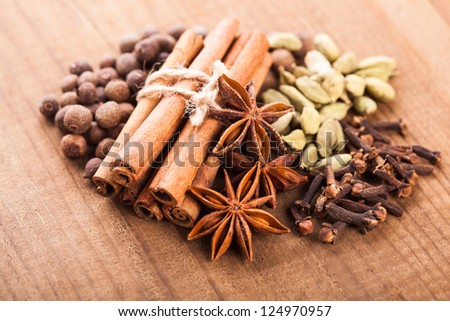Collection of spices for mulled wine and pastry on the wooden table