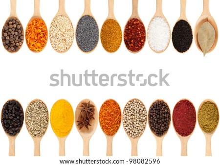 Collection of 18 spices on a wooden spoon. isolated on a white background
