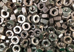 Collection of threaded nuts.Engineering Metal Tools.