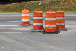 Collection of traffic safety barrels, road construction safety zone, horizontal aspect