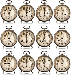 Collection of twelve old alarm clocks with all hours of the day, isolated on white background, photography.