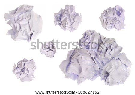 collection of various balls of paper on isolated