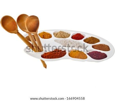 Collection of various color powder spices on a cooking  palette with spoons isolated on a white background  #166904558