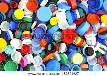 Collection of various colorful plastic screw caps. Usefull as background