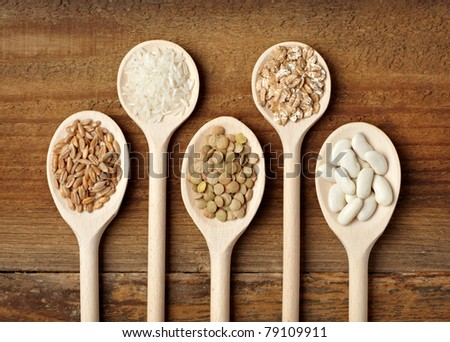 collection of various food ingredients in wooden spoon