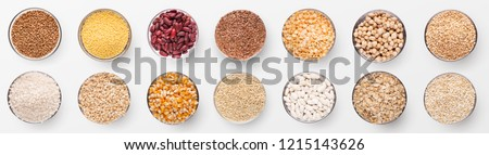 Collection of various grains in bowls isolated on white background, panorama, top view